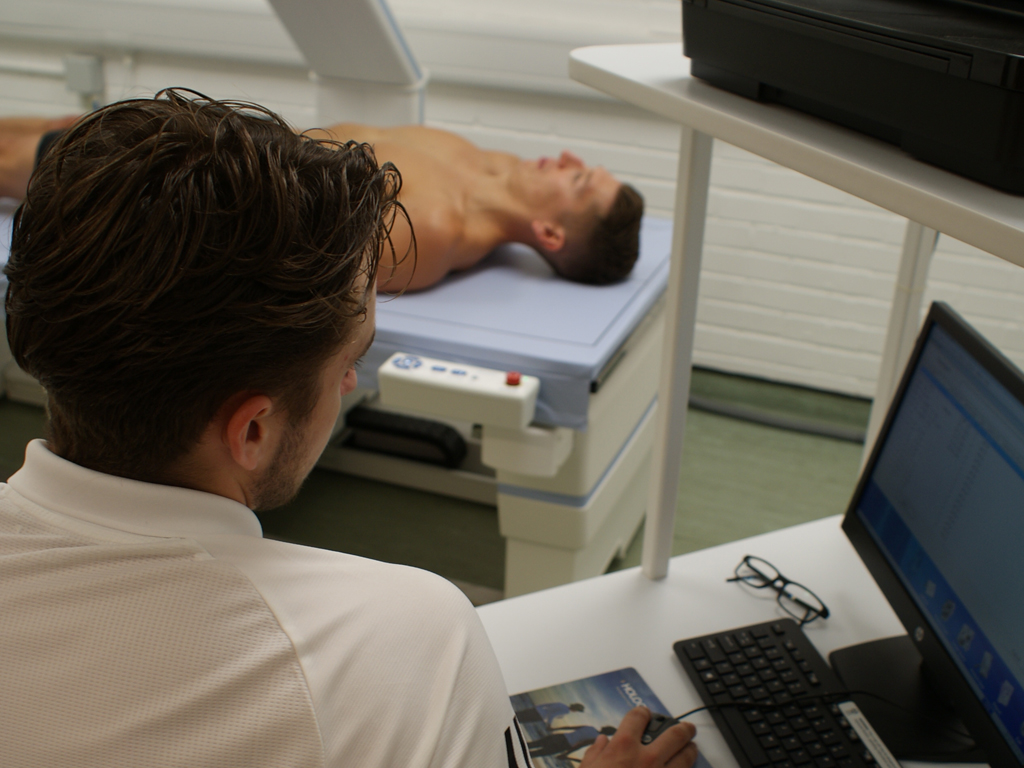 DXA scan performs body composition measurements