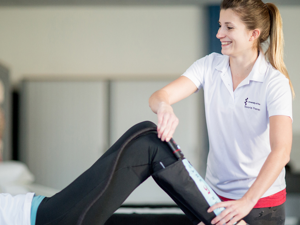 Therapist provides sports therapy assessment